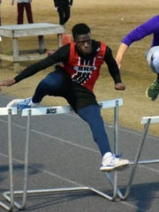 """Riverheads' Joshua Akinwumi competes in the 55-meter high hurdles during a """"Polar bear"""" track meet at Fort Defiance on Jan. 18."""
