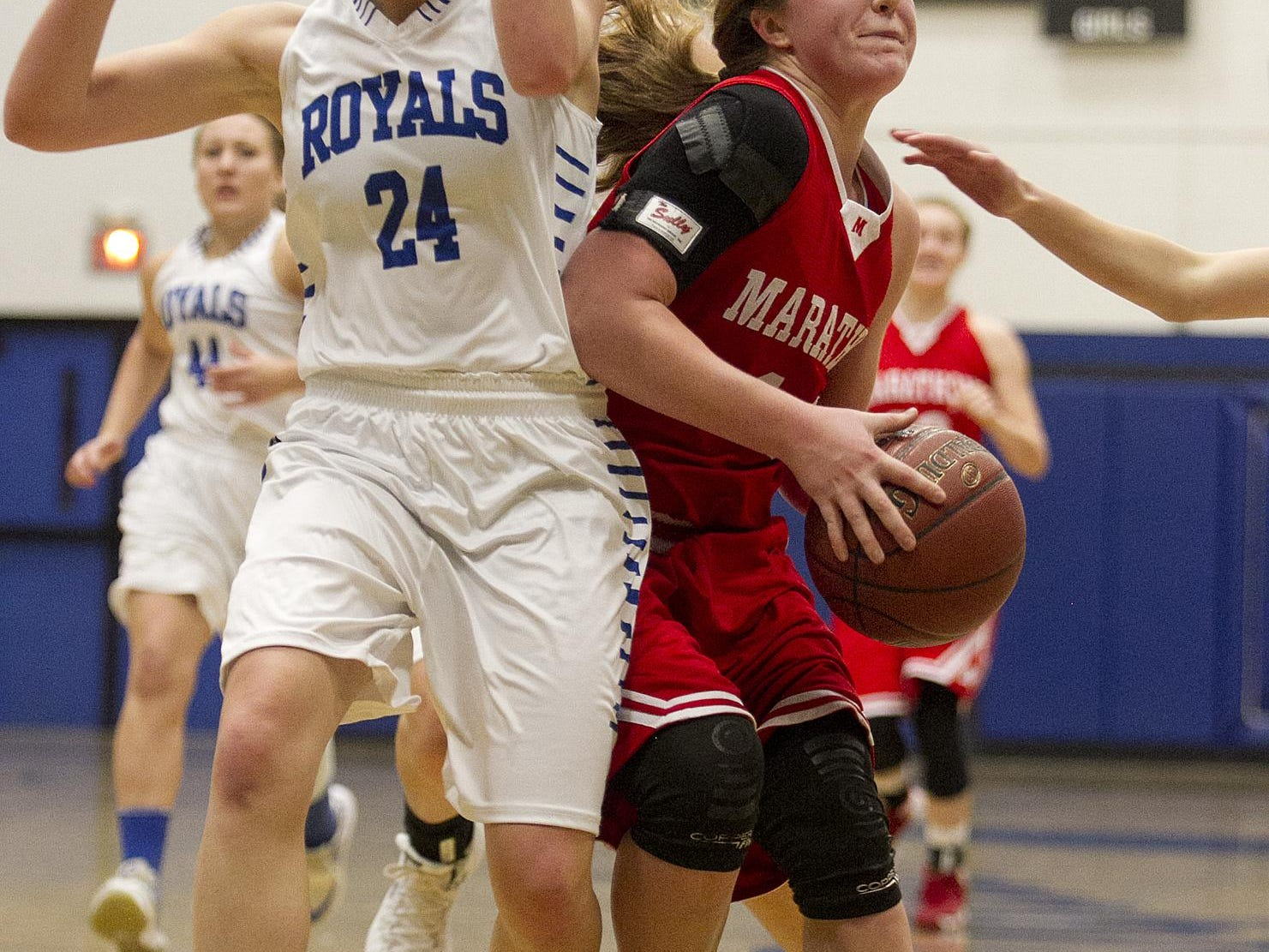 Marathon's Morgan Rachu, right, drives on a fast break against Assumption's Macie Zurfluh during the first half of the Marawood Conference girls basketball game Tuesday at Assumption High School in Wisconsin Rapids.