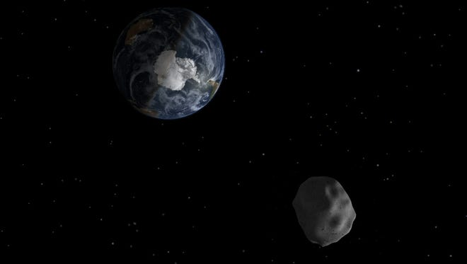 An artist's conception of a asteroid whizzing by the Earth in 2013.