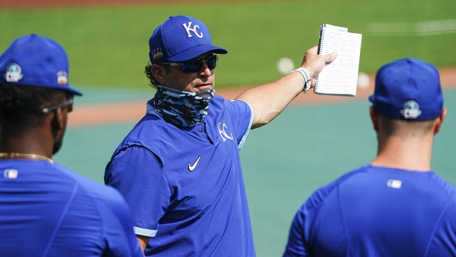Kansas City Royals manager Mike Matheny, middle, talks with players during summer workouts Friday at Kaufmann Stadium in Kansas City, Mo.