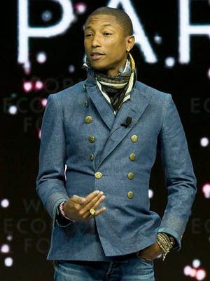 """US singer Pharrell Williams gestures as he speaks during the panel """"What's Next? A Climate for Action"""", at the World Economic Forum in Davos, Switzerland, Wednesday. The meeting runs through Saturday under the overarching theme """"The New Global Context""""."""