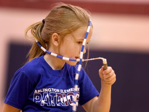 Ella Beck, 8, gets tangled up during a practice for Indy Air Bears, a jump roping group, at Arlington Elementary School in Indianapolis on Monday, Aug. 18, 2014.