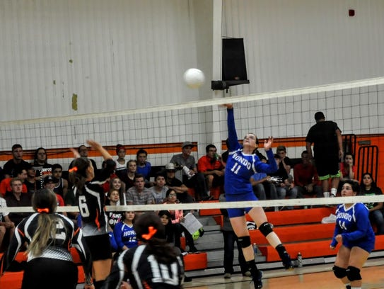 Joyce Cooper puts the ball over the net for Hondo as