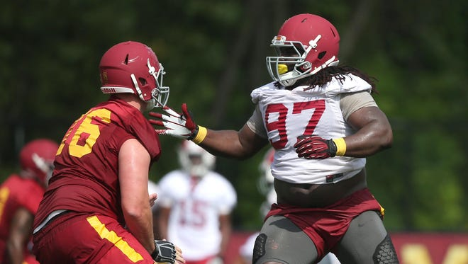 Iowa State junior defensive tackle Demond Tucker, right, pushes past senior offensive lineman Jamison Lalk during an open practice on Friday, Aug. 7, 2015, at the Iowa State practice facility near Jack Trice Stadium in Ames, Iowa.
