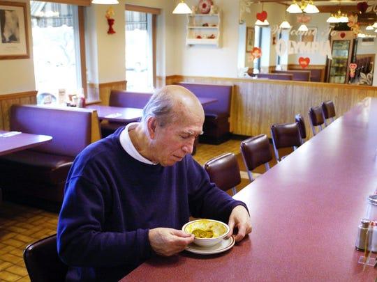Paul Kokorotsis enjoys a bowl of soup at Olympia Restaurant at Latta and Flynn roads in this 2005 file photo.