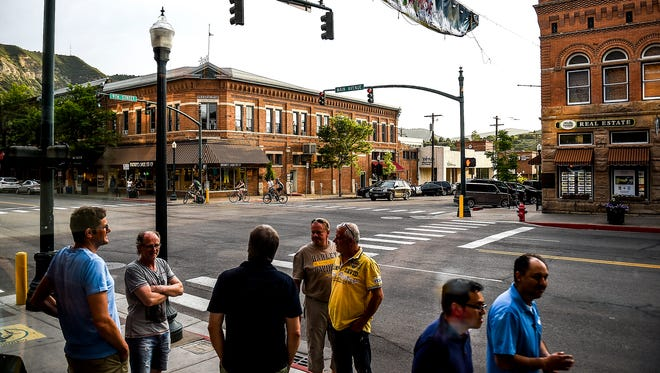 People walk along the streets of downtown Durango Tuesday, June 23, 2015.