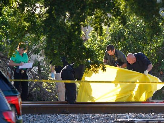 Broward County Sheriff's investigators examine a body