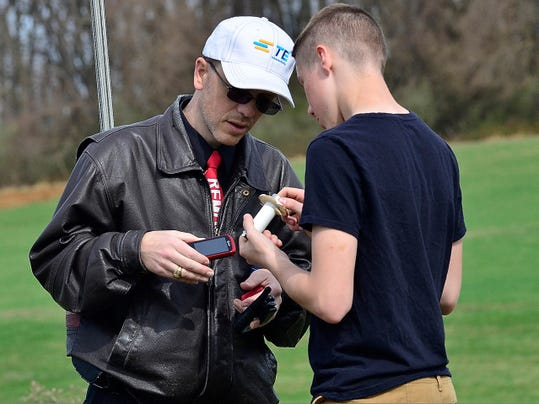 Spring Grove High School physics teacher Brian Hastings works with senior Wyatt Nace after a rocket part separated before leaving the launch pad as the school's team runs test flights in preparation for May's Team America Rocketry Challenge (TARC) finals in Virginia.
