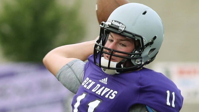 Kyle Castner of Ben Davis winds up for a throw down field. Ben Davis hosted Westfield in a football scrimmage Friday August 15, 2014.