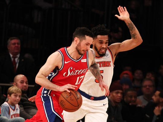Dec 25, 2017; New York, NY, USA; Philadelphia 76ers guard J.J. Redick (17) dribbles the ball against New York Knicks guard Courtney Lee (5) during the first half at Madison Square Garden. Mandatory Credit: Andy Marlin-USA TODAY Sports