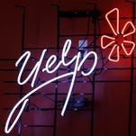 2011 file photo of the logo of the online review website Yelp, one of several companies being discussed as possible acquisition targets in the tech space