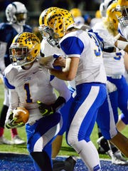Clyde's running back Conner Long (1), left, celebrates scoring a touchdown with Braydi Clark (34).