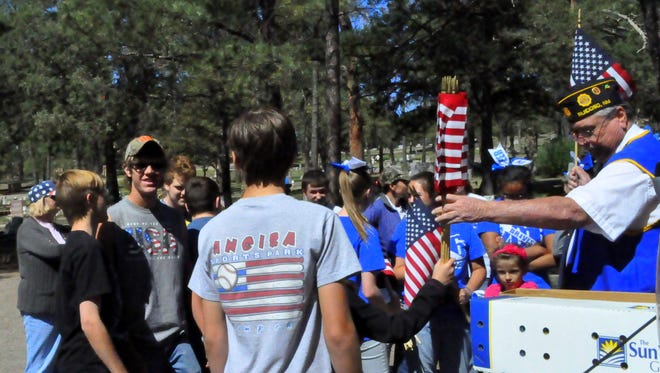 American Legion post 79, along with teens from Boy Scout troop 59, Girl Scout troop 33 and the Ruidoso Middle School cheerleaders remembered local deceased heroes Thursday in honor of Memorial Day.