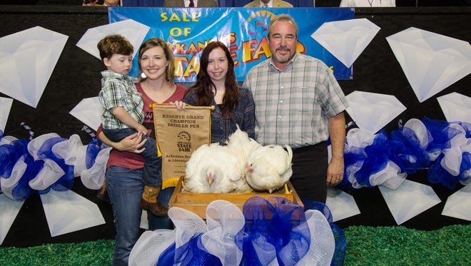 Mountain Home High School senior Chelsea Donaldson (second from right) is shown at the Arkansas State Fair with (from left) Leslie Jo Tucker and her 3-year-old son, Jack, and Wayne Freeman, of Hot Springs, representing the University of Arkansas, Division of Agriculture.