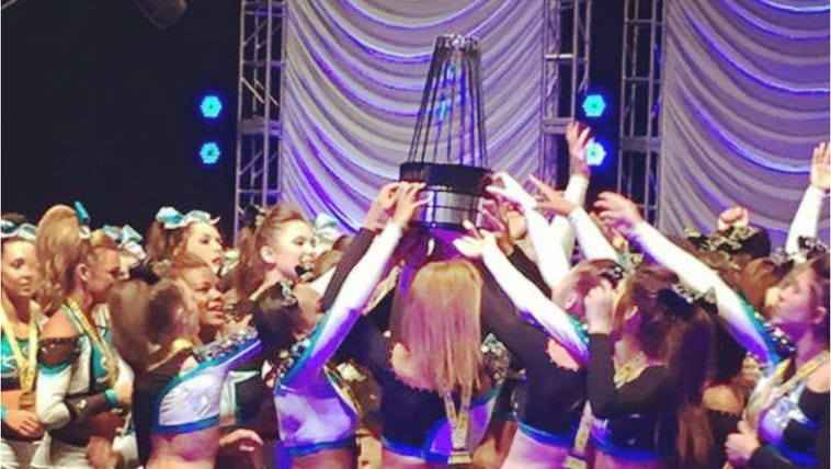 Members of the Cheer Extreme squad celebrate their