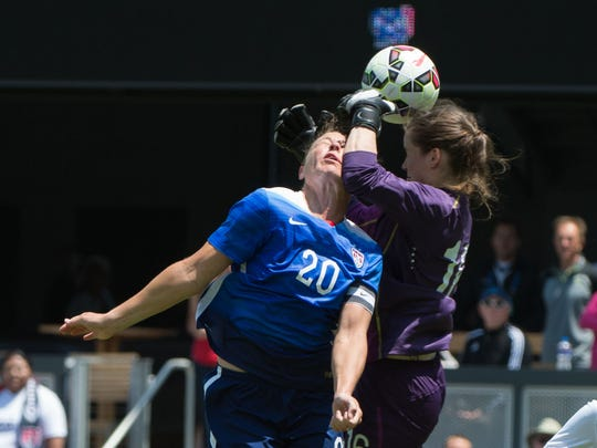 USA forward Abby Wambach (20) collides with Ireland goalkeeper Niamh Reid-Burke (16, right) during the second half.