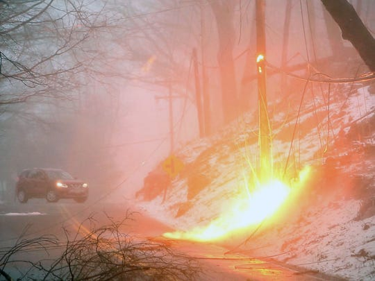 A live power line sparks in Somers, Westchester County after a March 2, 2018 snow storm.