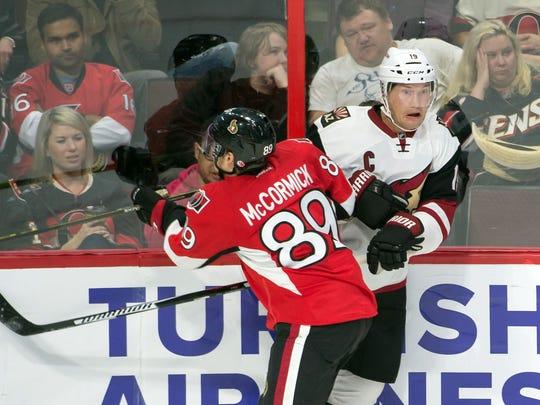 Ottawa Senators forward Max McCormick (89) checks Arizona Coyotes right wing Shane Doan in the third period Saturday at Canadian Tire Centre in Ottawa, Ontario. McCormick was making his NHL debut.