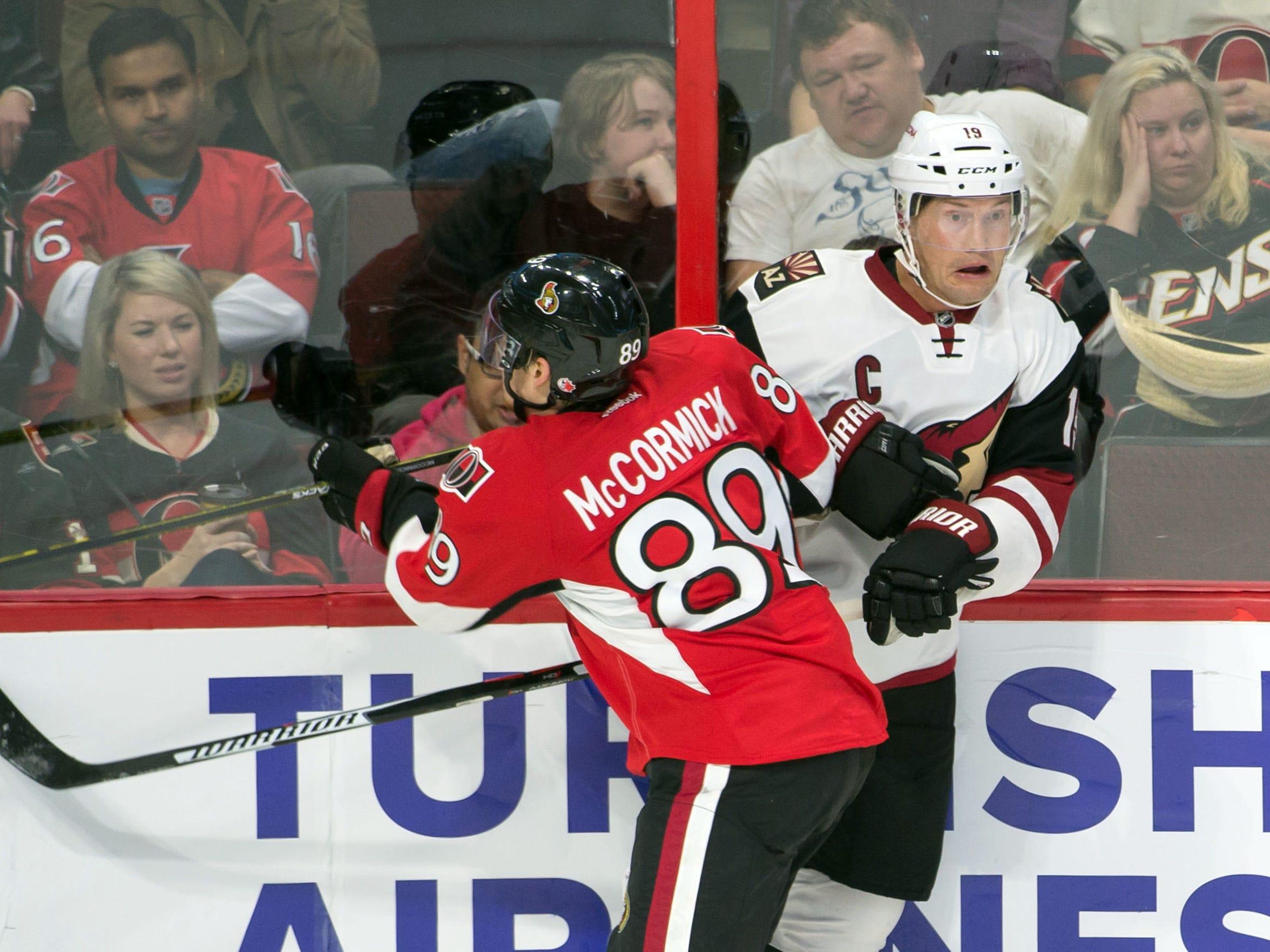 Green Bay Notre Dame product Max McCormick checks Arizona Coyotes right wing Shane Doan in his NHL debut with the Ottawa Senators.