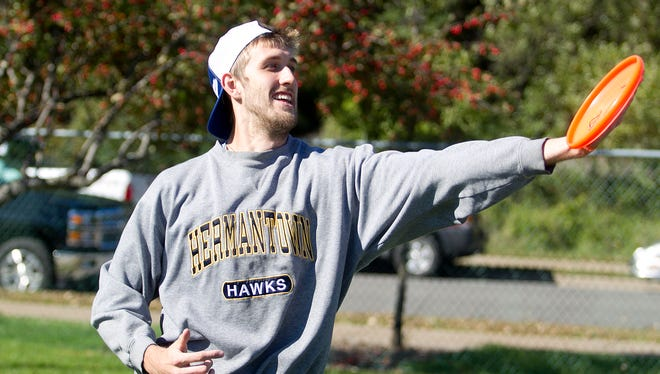 UWSP student Alex Tews, 22, practices cleanly catching the frisbee during practice with his Guts frisbee team, the Appleton Assassins.