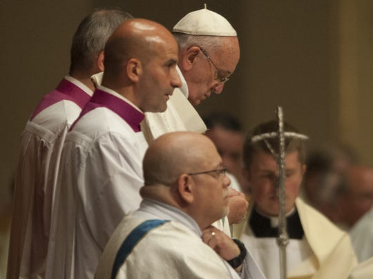 Pope Francis (center) takes celebrates the Votive Mass