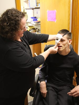 "Dodi McGlynn prepares Noah McGlynn for one of his roles during ""A Few of My Favorite Broadway Things"" show at Emmett Street Missionary Church Saturday evening"