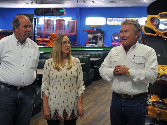 Kenny and Melanie Nordeen listen as Harry Patterson describes some of the updates and renovations planned for the Family Fun Zone, formerly The Plex. Patterson is part of a group of investors who recently purchased the facility and the Nordeens are owner/operators.