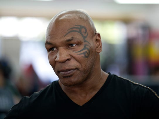 Former boxer Mike Tyson watches mixed-martial-arts