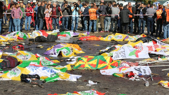 Bodies of victims are covered with flags and banners