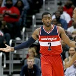 Washington Wizards guard John Wall (2) is not happy with the team's defensive effort.