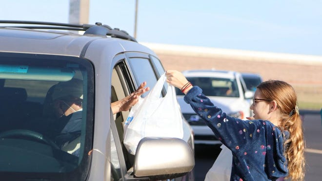 Because of crowd-size restrictions -- Harvey County lowered the limit to 10 people on Nov. 24 -- all meals at the Newton Community Thanksgiving Dinner were drive-thru or delivery only.