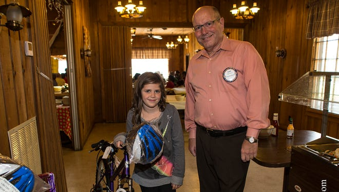 Working in conjunction with Oak Crest Elementary School, Pensacola North Rotary hosted a luncheon Dec. 11. During the event Santa presented 25 bicycles to students in attendance.