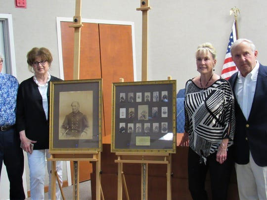 Former Mayor Eddy Ford and his wife Linda, left, were on hand for the unveiling of a gift to the town from donors Kay and William Stokely. The Stokelys collected these rare images of Admiral Farragut over the years and presented them in honor of Ford and Bob Leonard, Farragut's first two mayors.