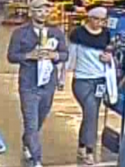 A photo of two suspects in a credit card skimmer case