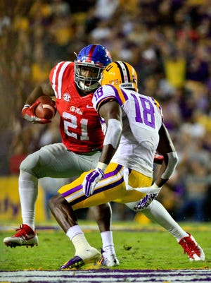 Oct 22, 2016; Baton Rouge, LA, USA; Mississippi Rebels running back Akeem Judd (21)runs the ball while being pursued by LSU Tigers cornerback Tre'Davious White (18) during the first quarter of a game at Tiger Stadium. Mandatory Credit: Derick E. Hingle-USA TODAY Sports