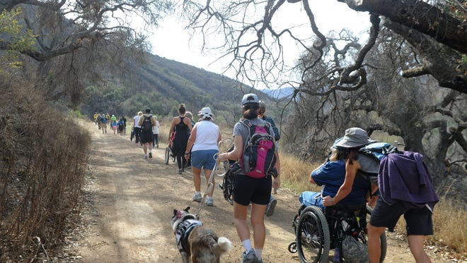 Participants travel on the dirt road at Point Mugu State Park on an earlier Wheels to the Sea adventure. Another one is scheduled for Saturday.