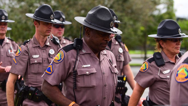 Florida State Troopers guard the perimeter of the Curtis M. Phillips Center for the Performing Arts in Gainesville on Thursday in preparation for Alt-Right leader Richard Spencer