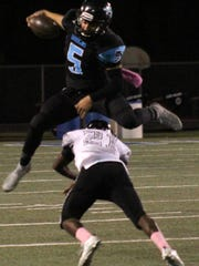 Santa Teresa's Dominick Dozal leaps over Alamogordo's Joshua Richardson.