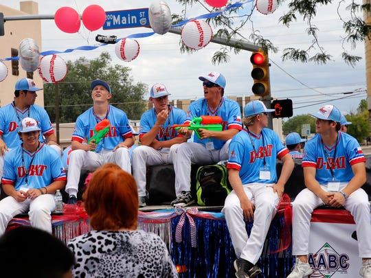 Members of the D-BAT baseball team participate in the Connie Mack World Series Parade Friday in Farmington.