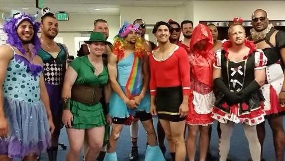 Reds rookies dress up for their trip from Milwaukee to Chicago following Sunday's game against the Brewers.