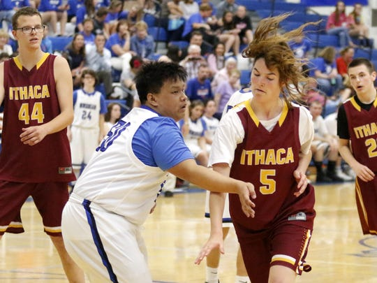 Steven Vo of Horseheads defends as Myah Frostclapp of Ithaca dribbles May 10 during a Unified Sports basketball game at Horseheads Middle School.