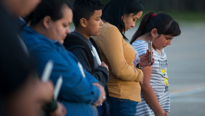 Community members attend a prayer vigil in the parking lot of the Bill Neal Center next to Channelview High School, Tuesday, March 13, 2018, in Channelview, Texas. The crash of a charter bus carrying a high school band from Florida to Texas left a driver dead and about three dozen people injured in south Alabama. The cause of the crash wasn't immediately known, but survivors from Channelview High School in metro Houston described being asleep one moment and tumbling through the air the next.
