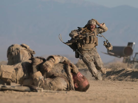 "John Cena (left) and Aaron Taylor-Johnson star in ""The"