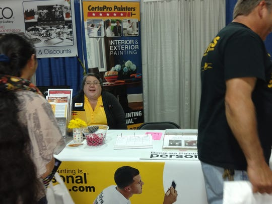 Rebeca Jimenez, owner of the CertaPro Painters franchise of Somerset County in the yellow is seen here.