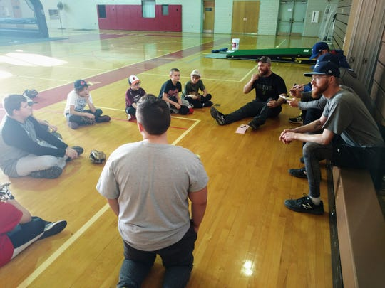 Attendees of Scotland Campus' baseball clinic sit down to chat.
