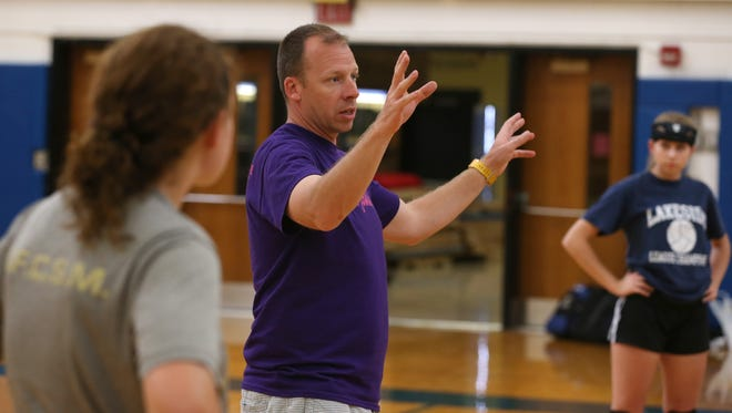 All eyes are on Shawn Strege, Webster Schroeder varsity volleyball coach, as he directs his squad through drills during practice at Schroeder High School Tuesday, Sept. 15, 2015.