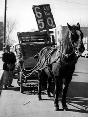 """This photo of John Lucas ran in December 1958. The original caption said: """"John Lucas, noted El Paso banana vendor, Wednesday was back at his old job with a new horse pulling his wagon. Nellie, his longtime business partner, died recently and John started looking for a new horse to take over the work. Her successor, Little Lady, here keeps one ear cocked for John's bidding. She's not as sharp as Nellie, John admits, but 'she'll learn.' """""""