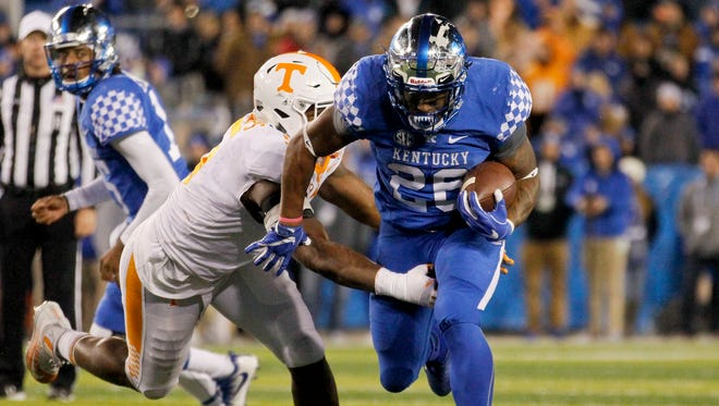 Oct 28, 2017; Lexington, KY, USA; Kentucky Wildcats running back Benny Snell Jr. (26) runs the ball against Tennessee Volunteers defensive lineman Kyle Phillips (5) In the second half at Commonwealth Stadium. Kentucky defeated Tennessee Volunteers 29-26. Mandatory Credit: Mark Zerof-USA TODAY Sports