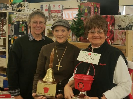 The Kitz and Pfeil True Value Hardware mini counter kettle collected $444, earning the 2016 Outstanding Mini Kettle Collection Site distinction and a traveling trophy the store staff plans to retain this kettle season. Pictured are, from left: Kay Schustedt, Marilynne Bowe, and K.T. Stephany holding their trophy. They invite community to come to their site and donate to their counter kettle to help them retain the title