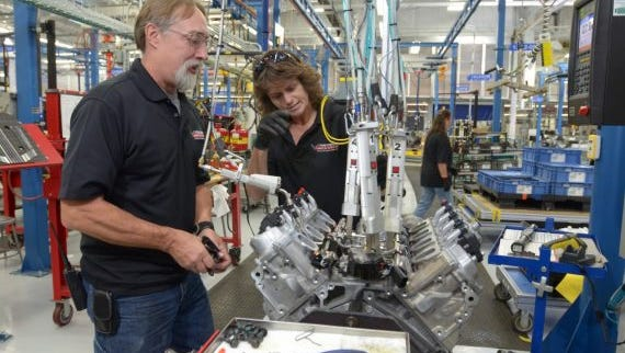 An Engine Builder performing an SIDI Check on a Corvette LT4 engine in the Performance Build Center Wednesday, October 22, 2014, at the plant in Bowling Green, Kentucky.